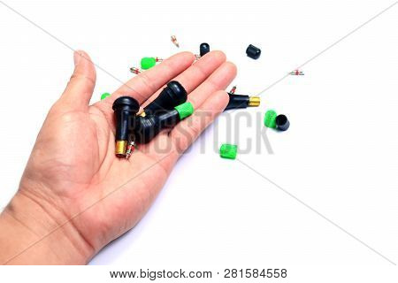 The Parts Of  Tyre Pressure Valve In Hand On White Isolated Background