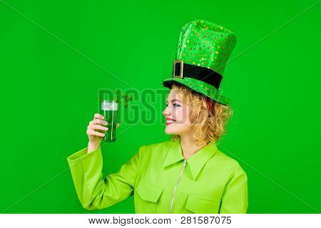 Saint Patrick's Day. Woman In Top Hat Holds Glass With Green Beer. St Patricks Day. Irish Beer. Gree