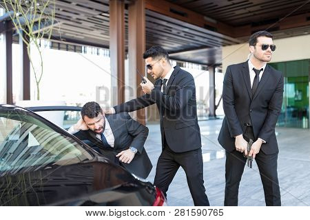 Young Latin Bodyguards Making Boss Reach Safely Towards Car During Attack