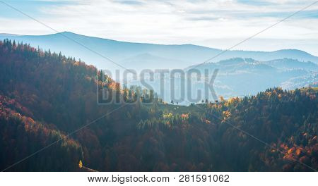 Beautiful Autumn Landscape In Mountains. Blue Hazy Afternoon In Countryside. Rolling Hills With Colo