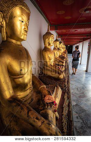 Row Of Golden Buddha Statues Wat Pho Palace Thailand Bangkok