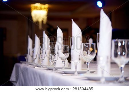 Empty Wine Glass On The Banquet Table.table Setting For A Banquet Or Dinner Party.
