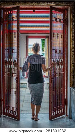 Woman Opens An Iron Gate Walks Into The Temple
