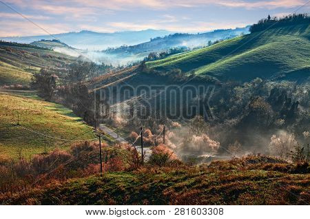 Castrocaro Terme e Terra del Sole, Forli-Cesena, Emilia Romagna, Italy: landscape at sunrise of the picturesque hills with fog in the valley poster