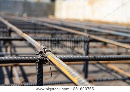 Tie Rebar Beam Cage On Construction Site. Steel Reinforcing Bar For Reinforced Concrete.