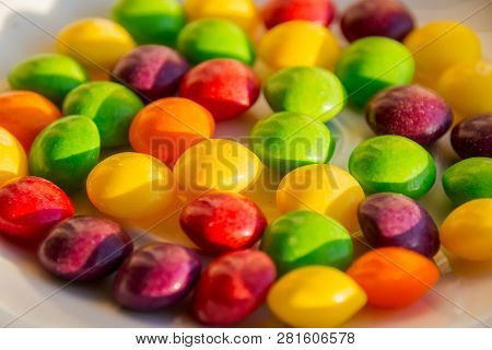 Scattered Dragees Of Different Colors. A Colorful Background.closeup Of The Pile Of Colorful Sweet B