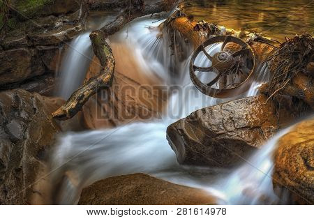 Possibly A Wheel From An Abandoned Welsh Coalmine, In The River At Melincourt Brook, Resolven, South