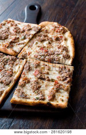 Turkish and Arabic Traditional Ramadan Bread Sliced Etli Ekmek Kebab with Minced Meat (Pide or Lahmacun Kebap) serving on wood by Konya or Sivas poster