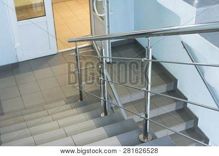 Emergency And Evacuation Exit Stair In The Building. Interior With Stair In Clinic. Stairs From Top