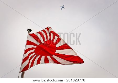 The Flag, Or Ensign, Of The Imperial Japanese Navy Waving In The Wind.