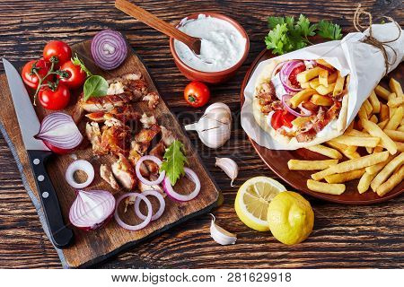 Overhead View Of Greek Souvlaki, Pita Ma Gyros With Chicken Meat, Vegetables, French Fries And Yogur