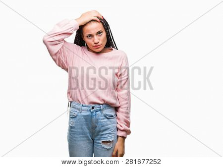 Young braided hair african american girl wearing sweater over isolated background confuse and wonder about question. Uncertain with doubt, thinking with hand on head. Pensive concept.