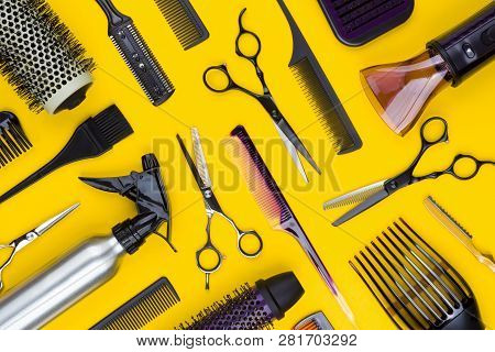 Hairdresser Tools And Combs Tools On Yellow Background, Top View