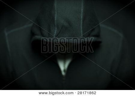 Shallow depth of focus shot of Man Wearing Hoodie Looking Down.