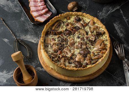 Mushroom Quiche Pie With Champignons And Cheese On Dark Background, Top View. Savory Tart With Mushr