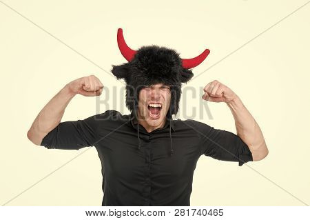 Feeling so angry. Man shouting face wears hat of devil with horns. Guy black shirt angry aggressive demonstrate strength gesture. Man emotional screaming. Guy angry as devil isolated white background. poster