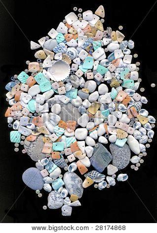 Beautiful seashells with beads on black background