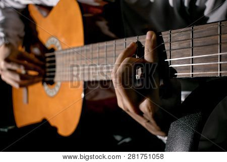 Guitarist Hands And Guitar Close Up. Playing Classic Guitar. Play The Guitar. Low Key Image.