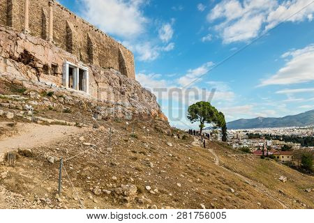 Athens, Greece - November 1, 2017: Tourists At The Foot Of Acropolis In Athens, Greece. Popular Tour