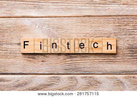 Fintech Word Written On Wood Block. Fintech Text On Wooden Table For Your Desing, Concept