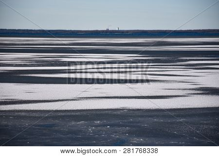 Snow Pattern On The Ice In The Baltic Sea By The Coast Of The Swedish Island Oland