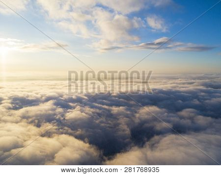 Aerial View White Clouds In Blue Sky. Top View. View From Drone. Aerial Bird's Eye View. Aerial Top