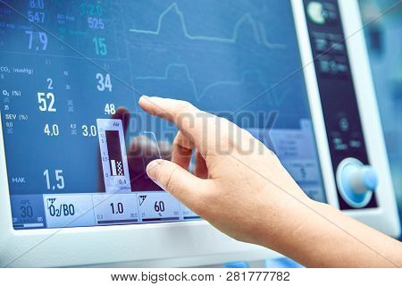 Monitoring Patients Vital Sign In Operating Room. Doctor Cheking At Patients Vital Signs. Cardiogram