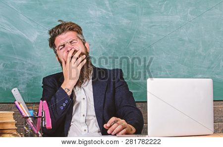 Educators More Stressed At Work Than Average People. High Level Fatigue. Educator Bearded Man Yawnin