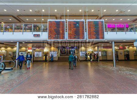 Riga, Latvia - May 7, 2017:  Electronic Timetable Of Trains,  Passengers And Indoor Veiw With Passen