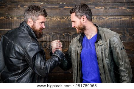 Strong Handshake. Friendship Of Brutal Guys. Handshake Symbol Of Successful Deal. Approved Business