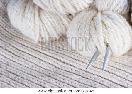 craft background - knitting, wool, needles