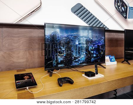 Paris, France - Dec 16, 2018: Apple Computers Tv 4k With Ipad And Joystick Connected To Wide 4k Tele