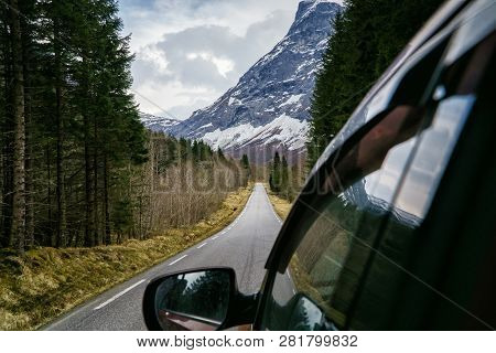 Scenic Beautiful Road Leading To The Mountains, View From The Car Window. Travelling In Norway, Scan