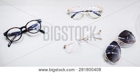 Multiple Luxury Golden And Plastic Eyewear Frames At Optometrist Eyewear Cabinet