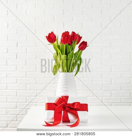 Red Tulips In White Vase With Gift Box With Red Ribbon