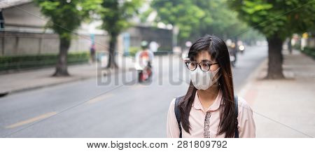 Young Asian Woman Wearing N95 Respiratory Mask Protect And Filter Pm2.5 (particulate Matter) Against