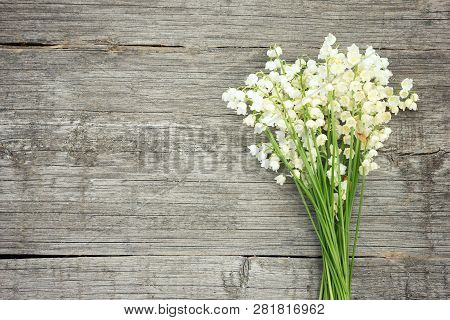 Bouquet Of Lilies Of The Valley On A Wooden Background. Beautiful Floral Frame With Lilies Of The Va