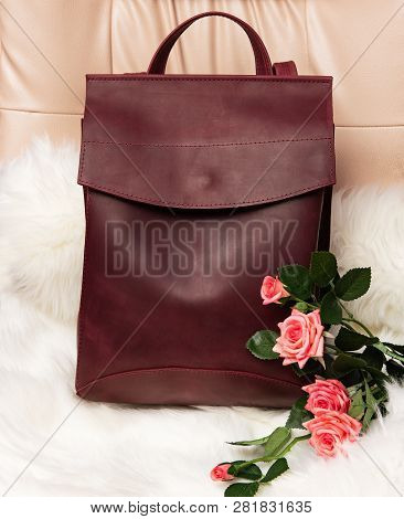 Burgundy Leather Backpack On Leather  Chair, Womens Leather Backpack
