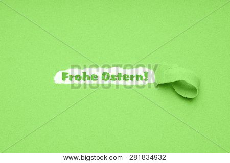 Frohe Ostern is German for Happy Easter - hole torn in green paper background to reveal easter greeting poster