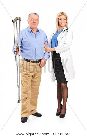 Full length portrait of a female doctor or nurse holding a senior patient with crutches isolated on white background