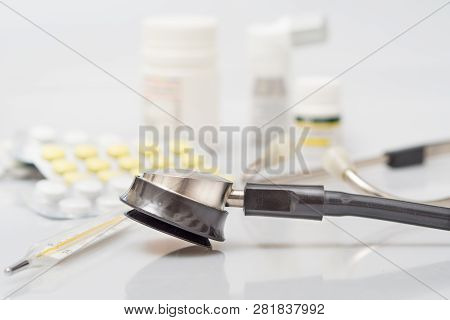 Medical Thermometer And Pills On White Background. Medicines And Medical Thermometer.