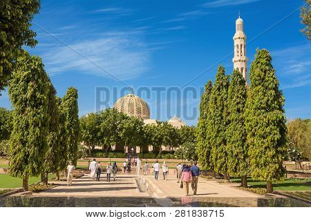 Muscat, Oman - November 4, 2018: Gardens Of The Grand Mosque Of Muscat (oman) And Tourists And Faith