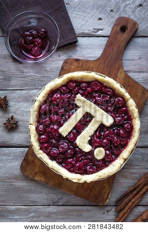Pi Day Cherry Pie - Making Homemade Traditional Cherry Pie With Pi Sign For March 14th Holiday, On W