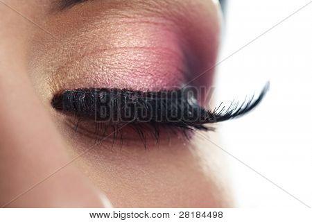 Closeup of a female eye with long false eyelashes