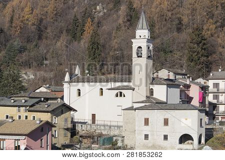 Church In A Coutryside With Many Houses And Trees Composition
