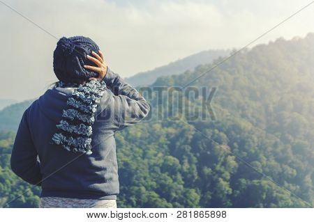 Young Woman Relaxing In Natural Park On The Moutain.travel Relax In Thailand.