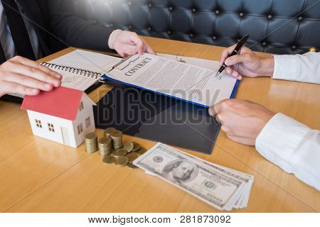 Estate Agent Giving House Keys Customer Sign Agreement Property For Sale, Buying And Selling Homes C