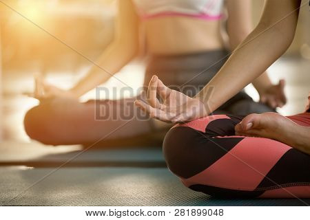 Close Up Hands Of  Woman Doing Yoga Exercising Meditation . Group Of Girl Meditate Sitting In Lotus