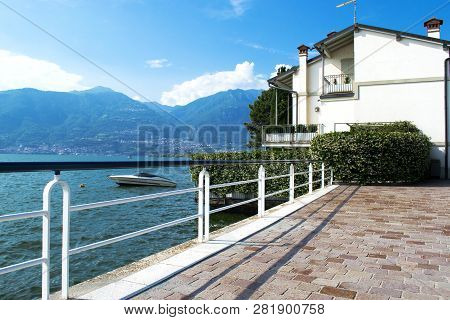 Beautiful View Of The Coast Of Italy. Lake With Along The Coast Of Italy. Sunny Day On The Coast Of