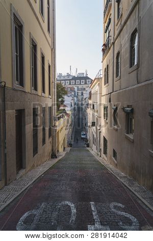 Long And Narrow Street In Chiado Lisbon, Portugal. Elevation, Ramp, Hill Going Up And Down. Slope Wi